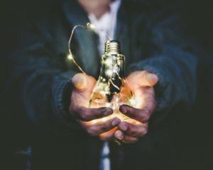 man holding idea bulb, Jasdeep Singh UConn CT