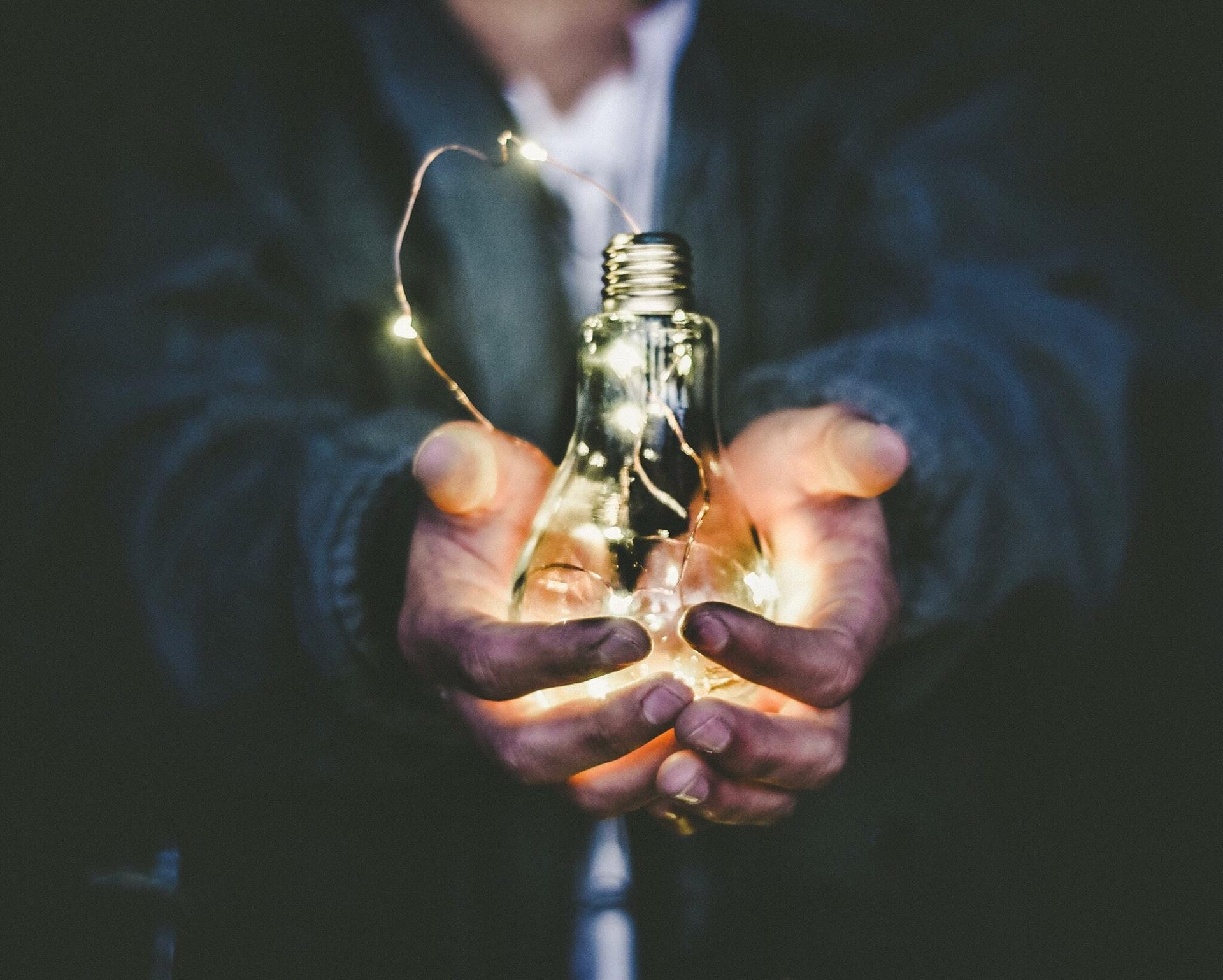 man holding idea bulb, Jasdeep Singh,
